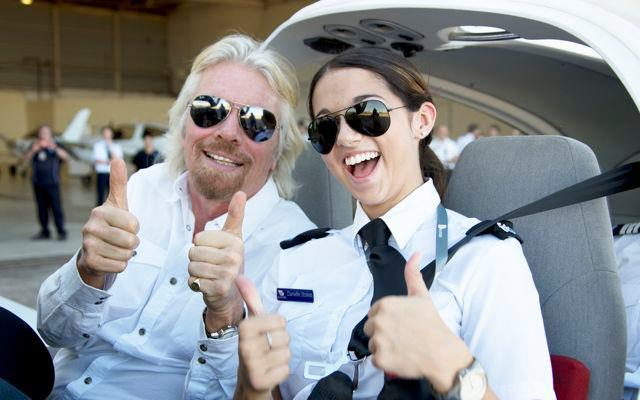 Richard Branson with a Young Female Pilot